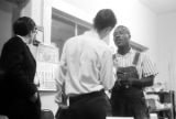 Roosevelt Barnett speaking to two men in an office, possibly the headquarters of the SCLC in Montgomery, Alabama.