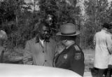 Herman Richardson speaking to an officer from the Macon County Sheriff's Department during a student demonstration in Tuskegee, Alabama, to protest the murder of Samuel L. Younge, a civil rights worker.