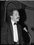 African American man speaking at a ballroom lectern, Los Angeles, 1985