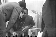 Richard Boone speaking to Albert Turner during a meeting at Maggie Street Baptist Church in Montgomery, Alabama.