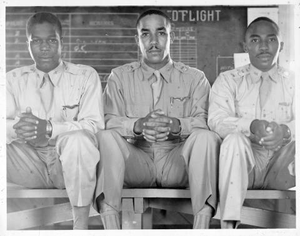 Chaplain Major D.L.T. Robinson, TAAFlf, and two unidentified flight instructors