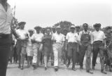 """Whitney M. Young, Juanita Abernathy, Ralph Abernathy, Coretta Scott King, Martin Luther King, Jr., James Meredith, Stokely Carmichael, Floyd McKissick, and others, participating in the """"March Against Fear"""" through Mississippi."""