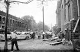 Damaged cars and debris in the street after the bombing of 16th Street Baptist Church in Birmingham, Alabama.