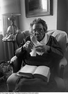 Photograph of Mable Chandler holding a book with a thumb index #2 Dallas/Fort Worth Black Living Legends Dallas/Fort Worth Black Living Legends, 1992