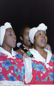 Singers performing at the Ashe Caribbean event Ashe Caribbean Dance