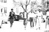 Witnesses for the prosecution in the trial of Thomas Coleman, walking down the street toward the Lowndes County courthouse in Hayneville, Alabama.