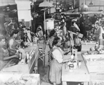 Jersey City Quartermaster Repair Sub-Depot; Negro women play an important part in the conservation activities of the Quartermaster Corps; This view shows portions of metal repair operations; Among the items repaired in this section are canteens, mess kits, canteen cups, etc