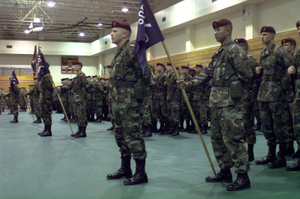 Soldiers of 3rd Brigade, 82nd Airborne Division, stand at parade rest during a ceremony commemorating the deactivation of the 555th Parachute Infantry Battalion and the integration of the unit, in December 1947, into 3rd Brigade, 82nd Airborne Division. The 555th is recognized as the first African-American unit to be integraded into the United States Army
