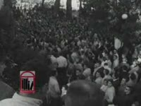 WSB-TV newsfilm clip of integration at the University of Georgia including crowds observing the arrival of African American students, students answering reporter's questions about integration and rioting in protest, and the African American students' return to Atlanta, Atlanta and Athens, Georgia, 1961 January 11