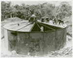 U.S. Navy African American Seabees covering a steel tank, South Pacific bases