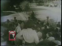 "WSB-TV newsfilm clip of police holding back white rioters protesting integration by the ""Little Rock Nine"" at Central High School in Little Rock, Arkansas, 1957 September 23"