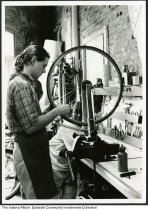 Daniel Herbert working inside a bicycle shop, Indianapolis, Indiana, circa 1985