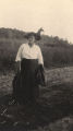 African American woman in a field in Madison County, Alabama.