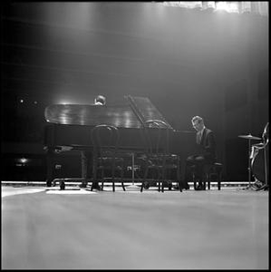 Dave Brubeck Quartet playing jazz, from behind