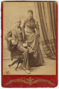 Photograph of a man and woman in formal clothes