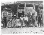 "Afro-Americans - Stockton: Billie Hart (father), with 8 children - Fred, Harrison, Leland, Dan, Chas, Alice, Willie and Bennet. Ruth (mother) and Ellen (daughter) are not in the picture taken - """"Only two more in the House"""""