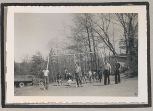 Photograph of four white men standing in front of a swingset where African American children are playing, Clarkesville, Habersham County, Georgia, 1950
