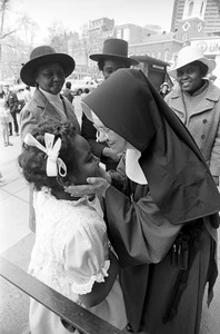 Nun greets black girl on Easter Day, Boston