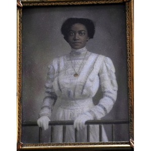 An African American woman clasping a railing.