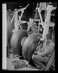 Manpower. Negro bomber plant workers. Landing gear for American medium bombers, which will carry destruction to the heart of the Axis, is assembled in a large Eastern aircraft plant. These skilled mechanics are products of the government's extensive training program for war workers. Glenn L. Martin Bomber Plant. Baltimore, Maryland