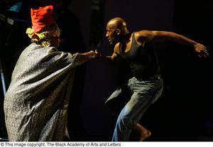 Performers grasp hands
