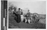 Reverend Carroll talks to two Korean men in Anshu, Korea, ca. 1930-1939