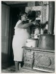 Mrs. Harry Handy canning corn with aid of pressure cooker. Saint Mary's County, Maryland, September 1940