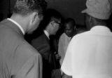 Roosevelt Barnett speaking to several men during a civil rights demonstration in downtown Montgomery, Alabama.