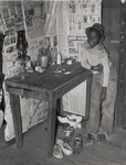 Corner of room of living quarters provided for Negro strawberry pickers near Independence, Louisiana, April 1939