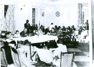 Photograph of Franklin Delano Roosevelt sitting at the head table during a special meal with Georgia Warm Springs Foundation patients, taken at the Georgia Warm Springs Foundation, Warm Springs, Meriwether County, Georgia, 1930-1940?