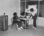 Students at the freshman voting table during campus elections at Tuskegee Institute in Tuskegee, Alabama.