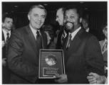 Presentation of B'nai B'rith Humanitarian award for assistance in re-settlement of Indo China refugee in the United States to Donald M. Payne, chairman of the World Alliance of YMCA; Refugee and Rehabilitation Committee by Vice-President Walter F. Mond...