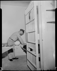Thumbnail for Guard Raymond Mazetis fixing the bed in a cell