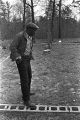 Roosevelt Bracy standing in an area lined with the cinder blocks, which will be the basis for his new house in Elmore County, Alabama.