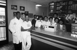 Thumbnail for Chicken Charlie's restaurant owners and staff posing together, Los Angeles, 1987
