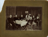 Six men at table