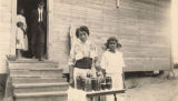 African American woman and young girl with jars of preserves in Madison County, Alabama.
