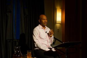 [E. Patrick Johnson Seated Onstage] Pouring Tea: Black Gay Men of the South Tell Their Tales