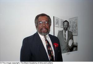 Abner Haynes posing with his portrait Dallas/Fort Worth Black Living Legends Dallas/Fort Worth Black Living Legends, 1991