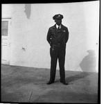 Police officer standing on sidewalk