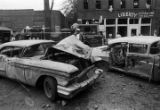 Damaged car in the street after the bombing of 16th Street Baptist Church in Birmingham, Alabama.