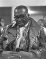Man sitting in an audience at St. Paul AME Church in Birmingham, Alabama, probably listening to Martin Luther King, Jr., speak.
