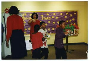 [Deborah Crawford and Students with Food During Christmas Party] San Antonio Chapter of Links Records