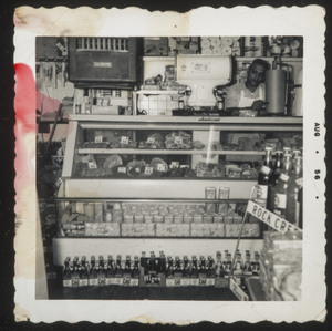 Almore Dale behind store counter