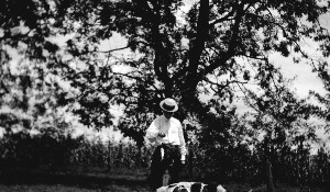 Unidentified man with dogs.