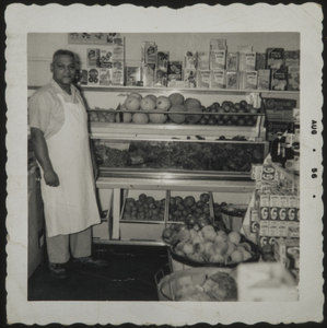 Almore Dale standing by fruit display