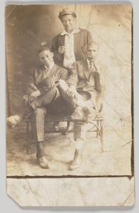 Photographic postcard of three unidentified men