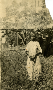 Francis Sullivan standing in yard