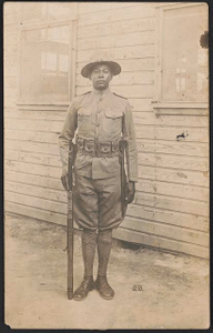 [Private Juneous H. Knox in uniform and campaign hat with rifle and knife hanging from cartridge belt]