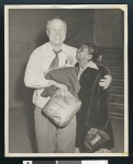Ernest Fox is greeted by Marguerite Robinson upon release from jail, Dec. 10, 1951, Federal Building, downtown Los Angeles